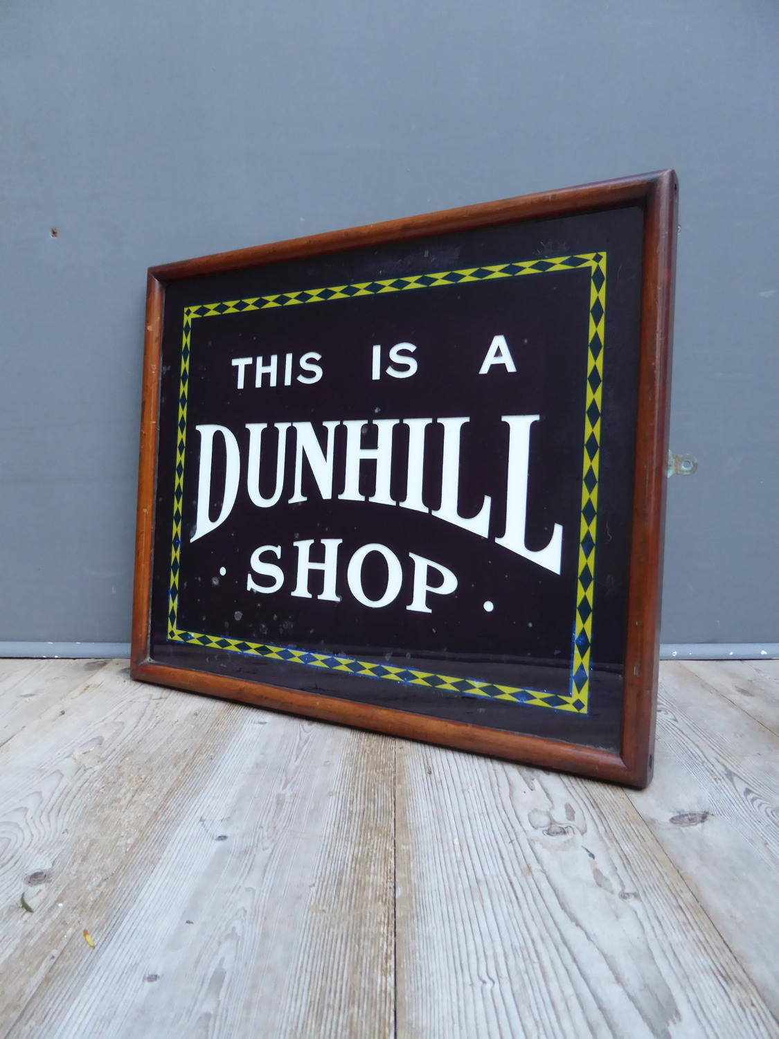 Glass Dunhill Shop Sign