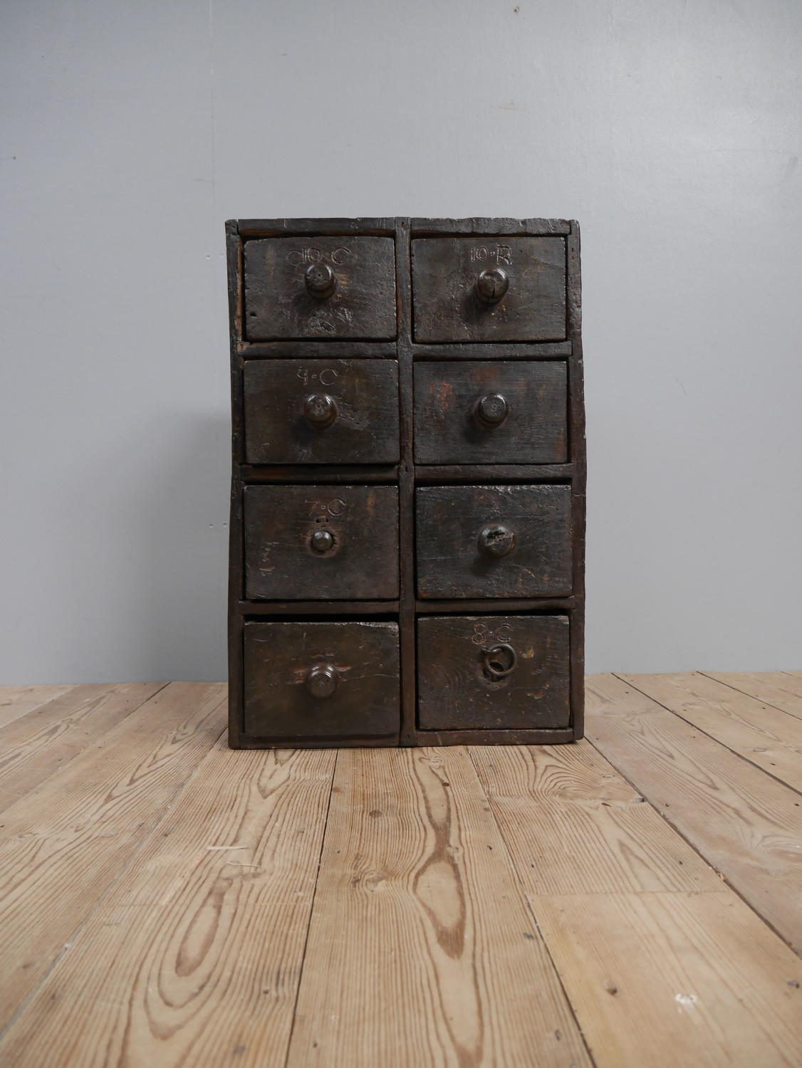 Bank of Early Elm Blacksmith's Drawers